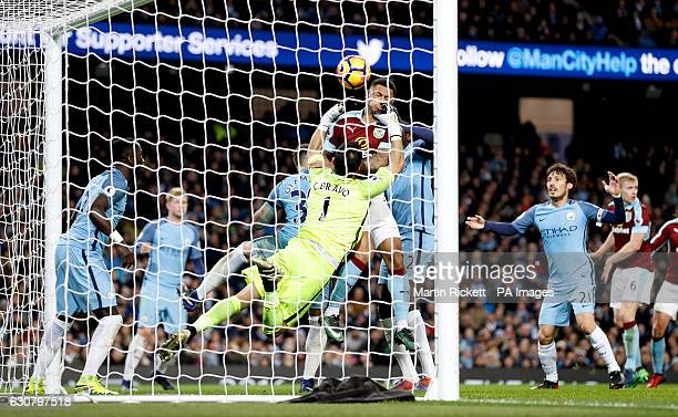 Manchester City goalkeeper Claudio Bravo scrambles to try and keep the ball out after Burnley's Ben Mee heads the ball over the line to score during...