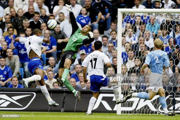 Manchester City goalkeeper David James saves a point blank header from Marcus Bent of Everton during their Barclays Premiership match at the City of...