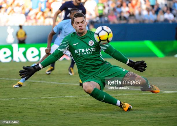 Manchester City goalkeeper Ederson Moraes deflects the shot of Tottenham Hotspur forward Vincent Janssen during the second half of a International...