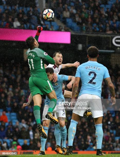 Manchester City goalkeeper Ederson punches the ball clear from Burnley's Ashley Barnes during the Premier League match at the Etihad Stadium...