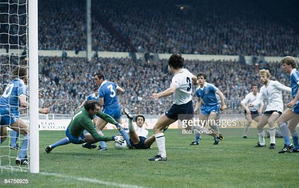 Manchester City goalkeeper Joe Corrigan saves from Tottenham Hotspur's Osvaldo Ardiles as Paul Miller moves in during the FA Cup Final at Wembley...