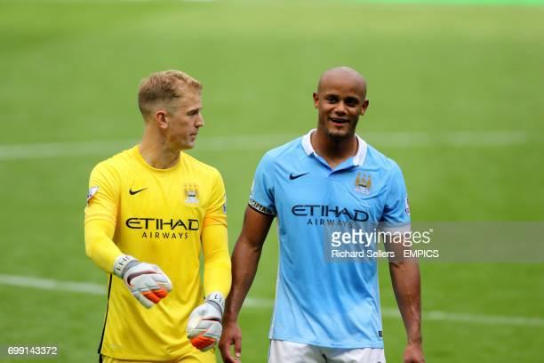 Manchester City goalkeeper Joe Hart and Manchester City's Vincent Kompany after the match