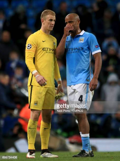 Manchester City goalkeeper Joe Hart and teammate Vincent Kompany chat after the final whistle