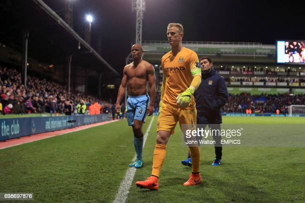 Manchester City goalkeeper Joe Hart and Vincent Kompany leave the pitch dejected