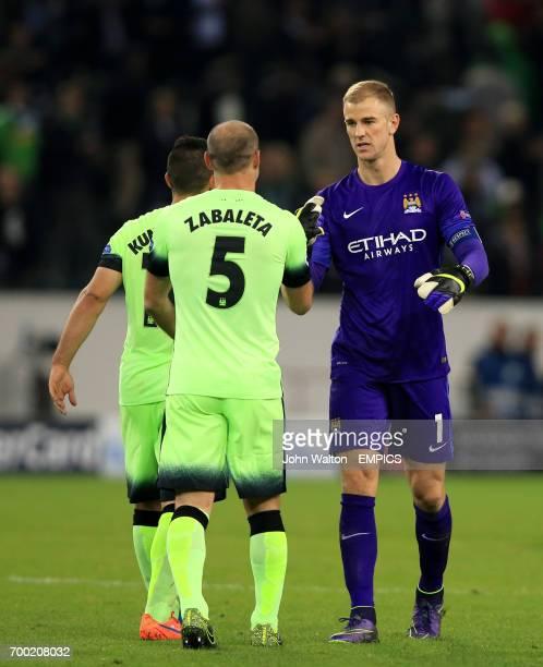 Manchester City goalkeeper Joe Hart celebrates after the final whistle with teammate Pablo Zabaleta