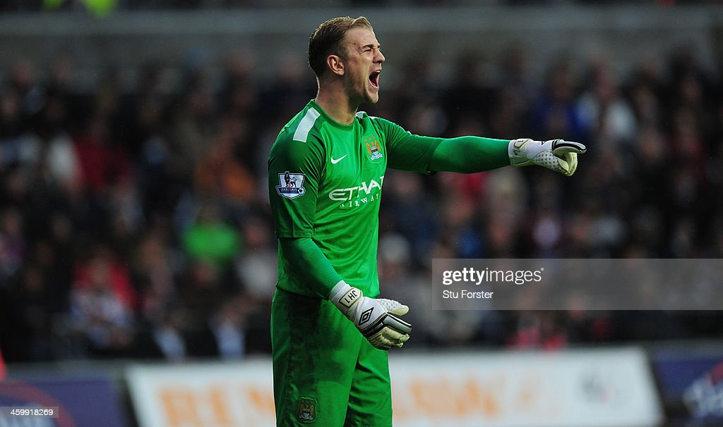 Manchester City goalkeeper <a gi-track='captionPersonalityLinkClicked' href=/galleries/search?phrase=Joe+Hart&family=editorial&specificpeople=1295472 ng-click='$event.stopPropagation()'>Joe Hart</a> in action during the Barclays Premier League match between Swansea City and Manchester City at Liberty Stadium on January 1, 2014 in Swansea, Wales.