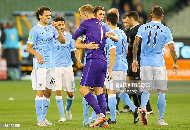 Manchester City goalkeeper Joe Hart is congratulated by teammates after making a save to win the penalty shoot out at the end of the International...