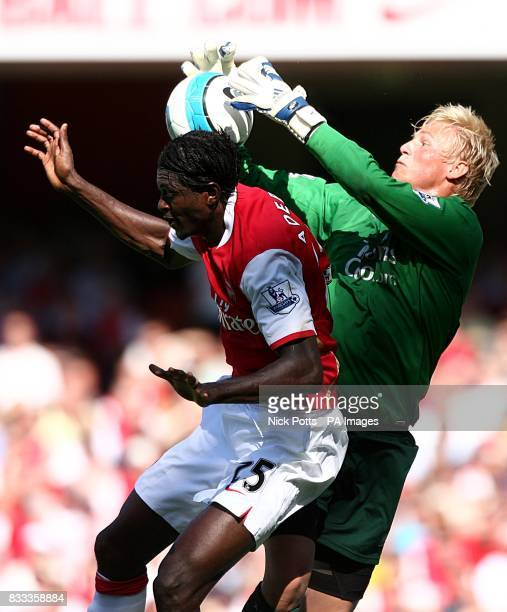 Manchester City goalkeeper Kasper Schmeichel and Arsenal's Emmanuel Adebayor battle for the ball in the air