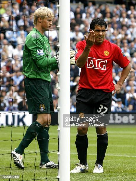 Manchester City goalkeeper Kasper Schmeichel and Manchester United's Carlos Tevez