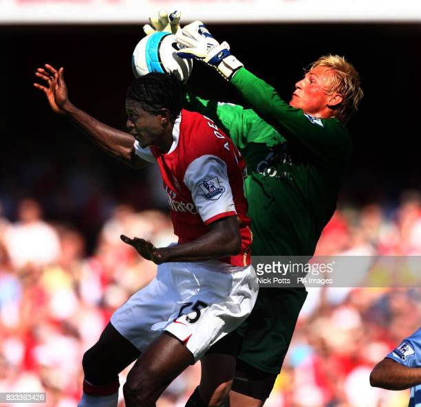 Manchester City goalkeeper Kasper Schmeichel saves off the top of Arsenal's Emmmanuel Adebayor head during the Barclays Premier League match at the...