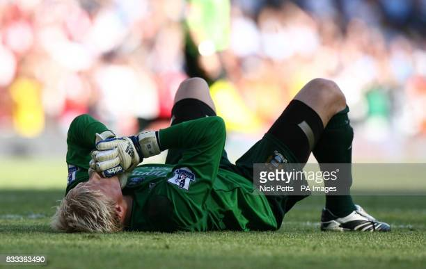 Manchester City goalkeeper Kasper Schmeichel shows his dejection after 10 defeat to Arsenal after the Barclays Premier League match at the Emirates...