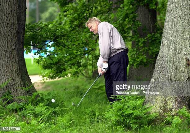Manchester City goalkeeper Peter Schmeichel plays out of the trees on the third hole at the Victor Chandler British Masters Proam at The Marquess...