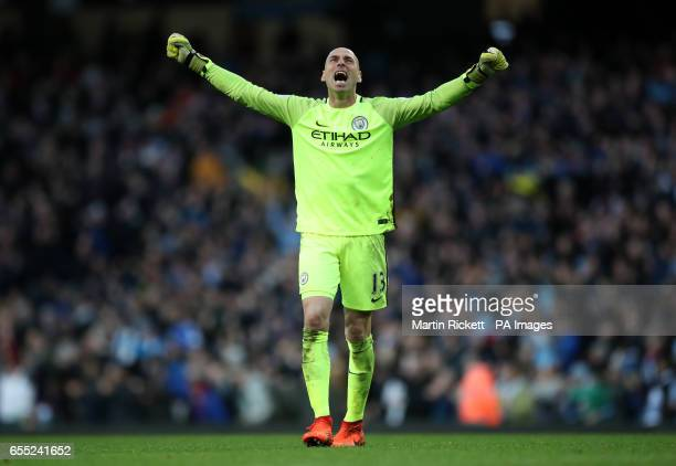 Manchester City goalkeeper Willy Caballero celebrates after Sergio Aguero scores his sides first goal of the game during the Premier League match at...