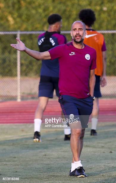 Manchester City head coach Pep Guardiola talks to a his player during a training session at the StubHub Center on July 25 2017 in Carson California /...