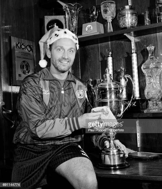 Manchester City manager Brian Horton polishing the silver and making a Christmas wish at Maine Road in Manchester circa December 1993