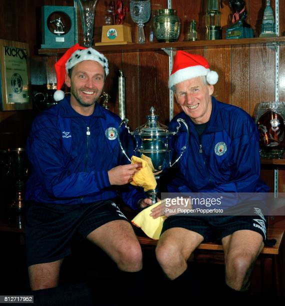 Manchester City manager Brian Horton with club legend Tony Book polishing the silver and making a Christmas wish at Maine Road in Manchester circa...
