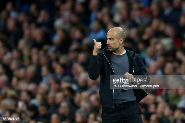 Manchester City manager Josep Guardiola gives his players a thumbs up during the UEFA Champions League group F match between Manchester City and SSC...