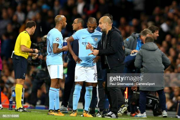 Manchester City manager Josep Guardiola shouts instructions to Fernandinho and Fabian Delph during a break in play during the UEFA Champions League...