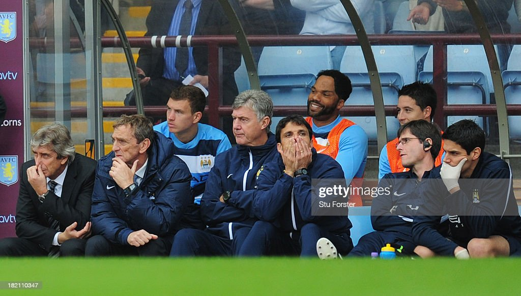 Manchester City manager Manuel Pellegrini (l) and his bench react during the Barclays Premier League match between Aston Villa and Manchester City at Villa Park on September 28, 2013 in Birmingham, England.