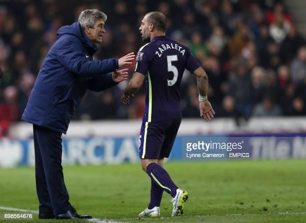Manchester City manager Manuel Pellegrini gives instructions to Pablo Zabaleta
