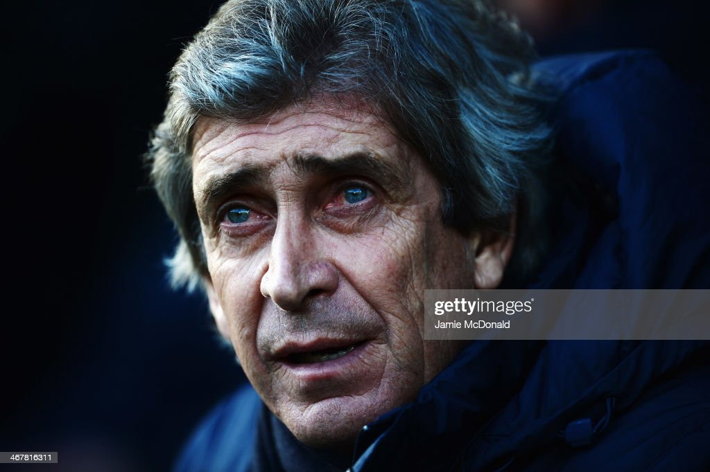 Manchester City manager <a gi-track='captionPersonalityLinkClicked' href=/galleries/search?phrase=Manuel+Pellegrini&family=editorial&specificpeople=673553 ng-click='$event.stopPropagation()'>Manuel Pellegrini</a> looks on before the Barclays Premier League match between Norwich City and Manchester City at Carrow Road on February 8, 2014 in Norwich, England.