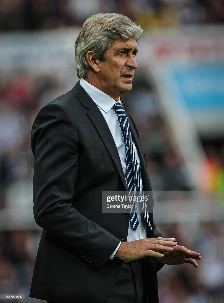 Manchester City Manager <a gi-track='captionPersonalityLinkClicked' href=/galleries/search?phrase=Manuel+Pellegrini&family=editorial&specificpeople=673553 ng-click='$event.stopPropagation()'>Manuel Pellegrini</a> signals a gesture from pitch side during the Barclays Premier League match between Newcastle United and Manchester City at St.James' Park on August 17, 2014, in Newcastle upon Tyne, England.