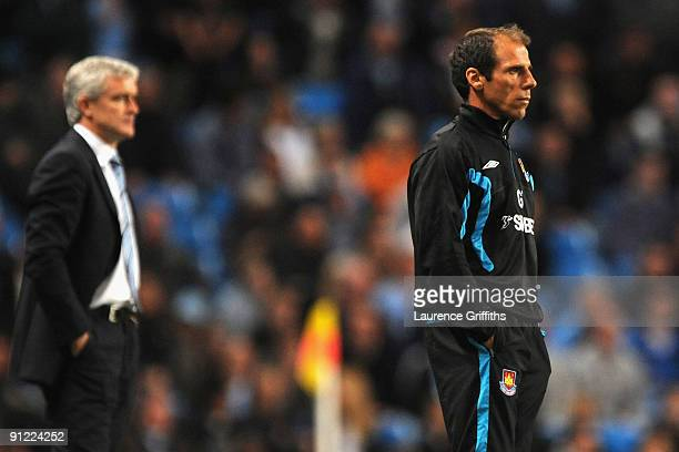 Manchester City Manager Mark Hughes and West Ham United Manager Gianfranco Zola watch the action during the Barclays Premier League match between...