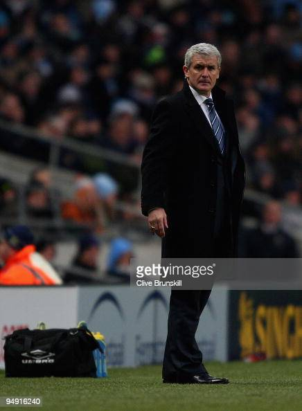 Manchester City manager Mark Hughes watches his players during the Barclays Premier League match between Manchester City and Sunderland at the City...