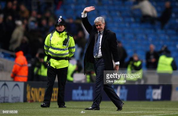 Manchester City manager Mark Hughes waves to the crowd after the Barclays Premier League match between Manchester City and Sunderland at the City of...