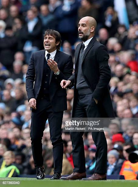 Manchester City manager Pep Guardiola and Chelsea manager Antonio Conte on the touchline during the Premier League match at the Etihad Stadium...