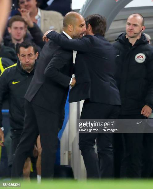 Manchester City manager Pep Guardiola and Chelsea manager Antonio Conte embrace after the final whistle of the Premier League match at Stamford...
