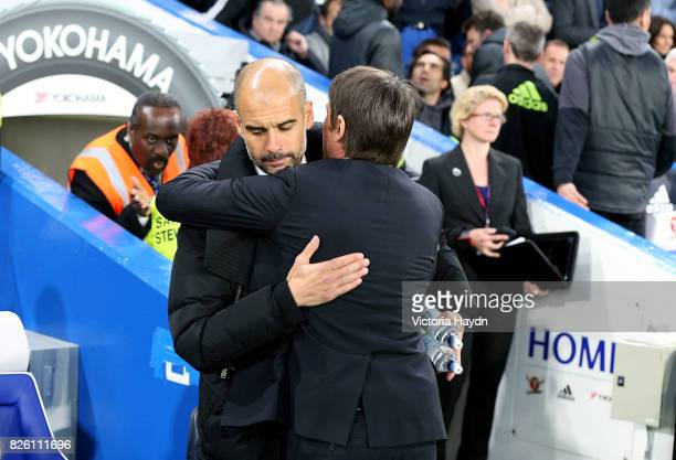 Manchester City manager Pep Guardiola and Chelsea manager Antonio Conte before kickoff