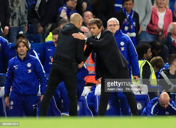 Manchester City manager Pep Guardiola and Chelsea manager Antonio Conte shake hands during the Premier League match at Stamford Bridge London