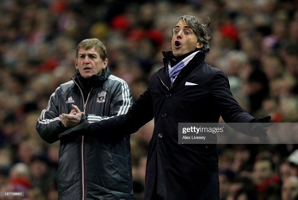 Manchester City Manager <a gi-track='captionPersonalityLinkClicked' href=/galleries/search?phrase=Roberto+Mancini&family=editorial&specificpeople=234429 ng-click='$event.stopPropagation()'>Roberto Mancini</a> (R) and Liverpool Manager <a gi-track='captionPersonalityLinkClicked' href=/galleries/search?phrase=Kenny+Dalglish&family=editorial&specificpeople=221580 ng-click='$event.stopPropagation()'>Kenny Dalglish</a> react during the Carling Cup Semi Final Second Leg match between Liverpool and Manchester City at Anfield on January 25, 2012 in Liverpool, England.