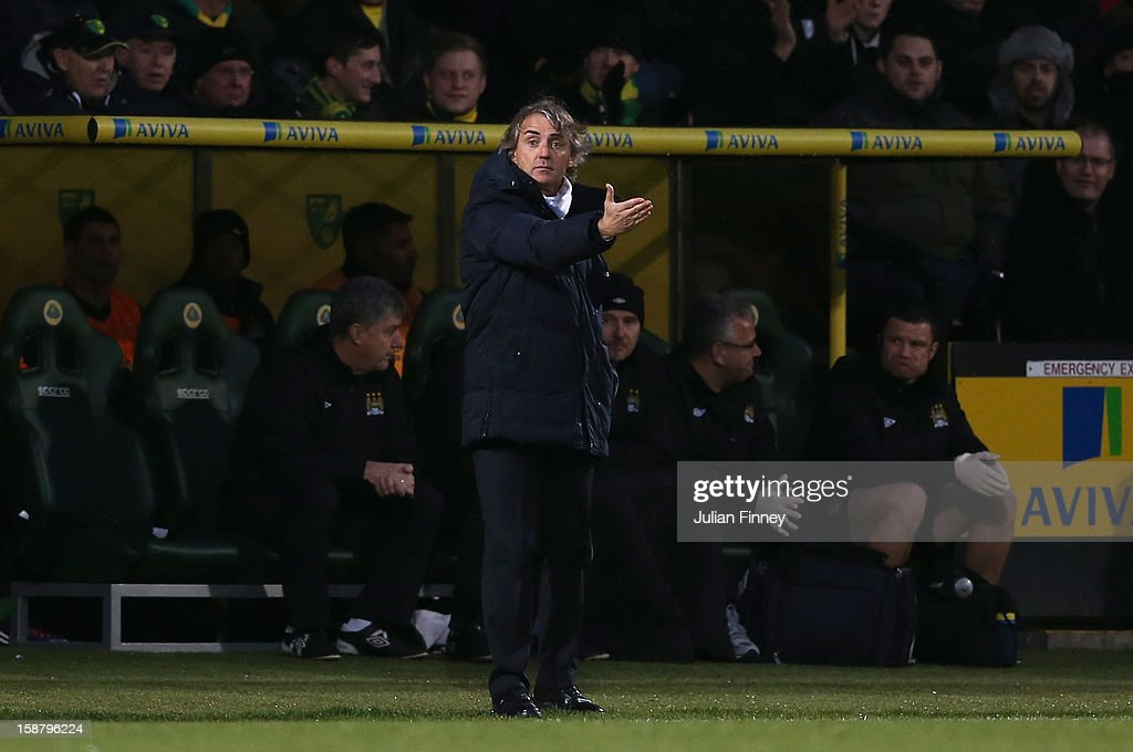 Manchester City manager <a gi-track='captionPersonalityLinkClicked' href=/galleries/search?phrase=Roberto+Mancini&family=editorial&specificpeople=234429 ng-click='$event.stopPropagation()'>Roberto Mancini</a> directs his team during the Barclays Premier League match between Norwich City and Manchester City at Carrow Road on December 29, 2012 in Norwich, England.