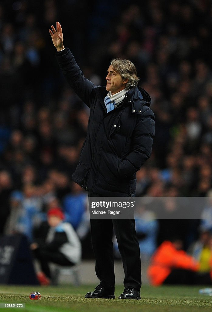 Manchester City Manager <a gi-track='captionPersonalityLinkClicked' href=/galleries/search?phrase=Roberto+Mancini&family=editorial&specificpeople=234429 ng-click='$event.stopPropagation()'>Roberto Mancini</a> gestures during the Barclays Premier League match between Manchester City and Stoke City at the Etihad Stadium on January 1, 2013 in Manchester, England.