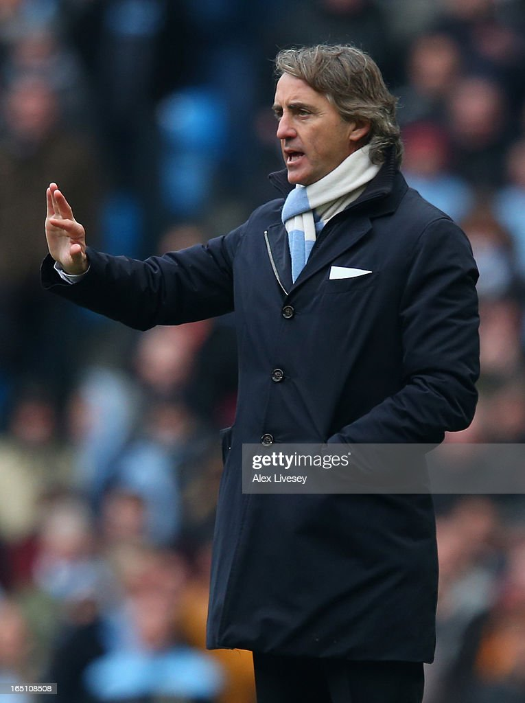 Manchester City Manager <a gi-track='captionPersonalityLinkClicked' href=/galleries/search?phrase=Roberto+Mancini&family=editorial&specificpeople=234429 ng-click='$event.stopPropagation()'>Roberto Mancini</a> gestures during the Barclays Premier League match between Manchester City and Newcastle United at the Etihad Stadium on March 30, 2013 in Manchester, England.