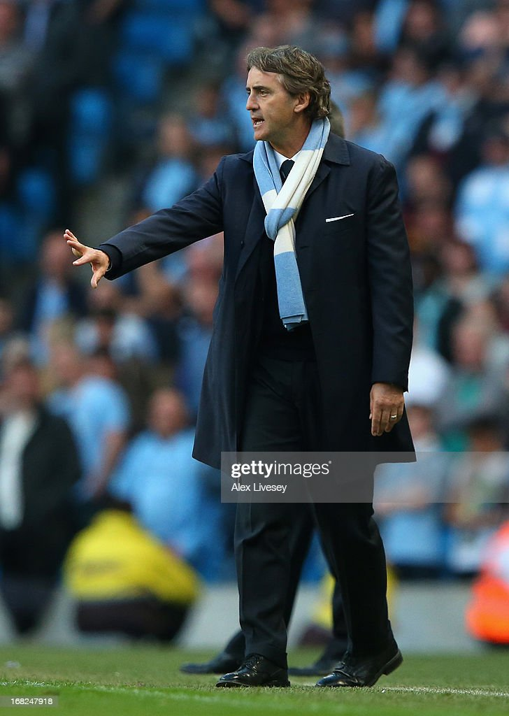 Manchester City Manager Roberto Mancini gestures during the Barclays Premier League match between Manchester City and West Bromwich Albion at the Etihad Stadium on May 07, 2013 in Manchester, England.