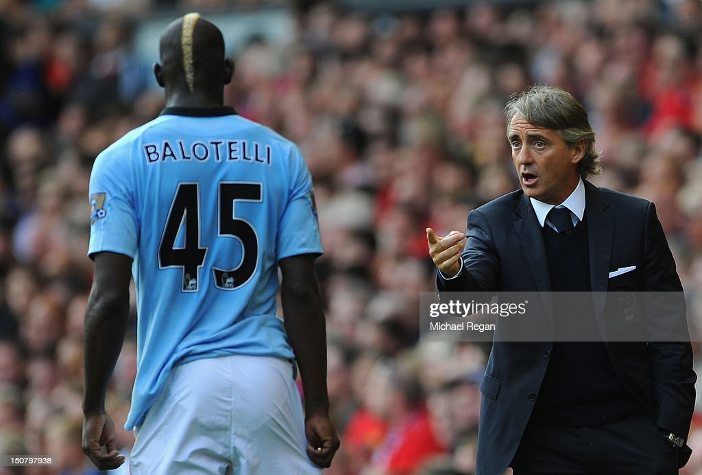 Manchester City Manager <a gi-track='captionPersonalityLinkClicked' href=/galleries/search?phrase=Roberto+Mancini&family=editorial&specificpeople=234429 ng-click='$event.stopPropagation()'>Roberto Mancini</a> gives instructions to <a gi-track='captionPersonalityLinkClicked' href=/galleries/search?phrase=Mario+Balotelli&family=editorial&specificpeople=4940446 ng-click='$event.stopPropagation()'>Mario Balotelli</a> of Manchester City during the Barclays Premier League match between Liverpool and Manchester City at Anfield on August 26, 2012 in Liverpool, England.