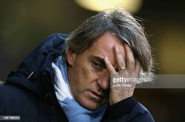 Manchester City manager Roberto Mancini looks on ahead of the Barclays Premier League match between Norwich City and Manchester City at Carrow Road...