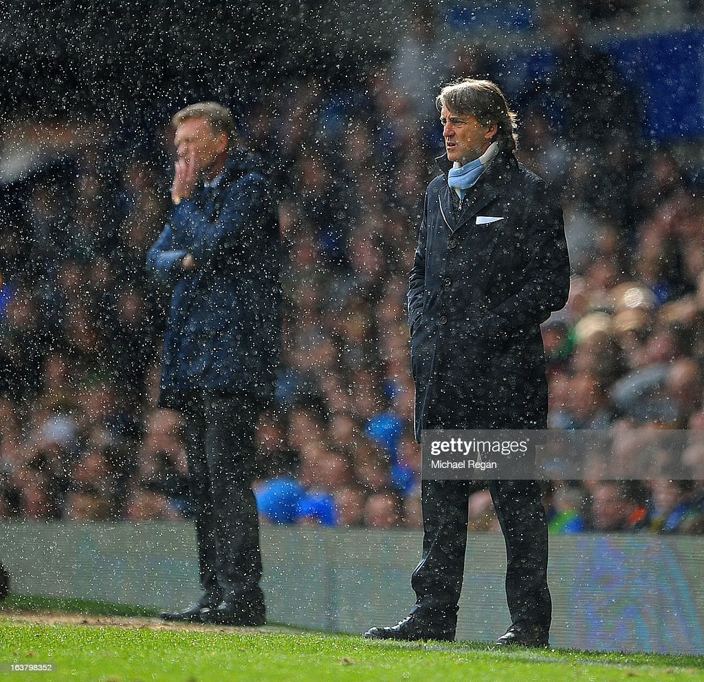 Manchester City Manager <a gi-track='captionPersonalityLinkClicked' href=/galleries/search?phrase=Roberto+Mancini&family=editorial&specificpeople=234429 ng-click='$event.stopPropagation()'>Roberto Mancini</a> looks on during the Barclays Premier League match between Everton and Manchester City at Goodison Park on March 16, 2013 in Liverpool, England.