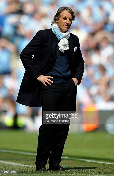 Manchester City Manager Roberto Mancini looks on during the Barclays Premier League match between Manchester City and Manchester United at the City...