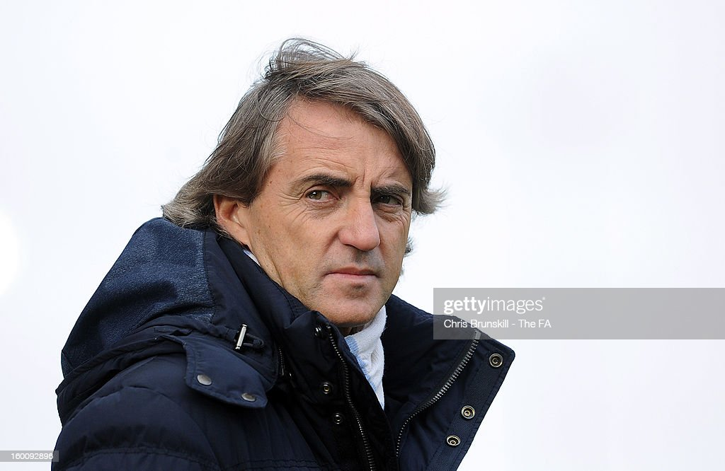 Manchester City manager <a gi-track='captionPersonalityLinkClicked' href=/galleries/search?phrase=Roberto+Mancini&family=editorial&specificpeople=234429 ng-click='$event.stopPropagation()'>Roberto Mancini</a> looks on during the FA Cup with Budweiser Fourth Round match between Stoke City and Manchester City at Britannia Stadium on January 26, 2013 in Stoke on Trent, England.