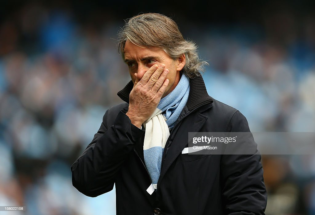 Manchester City Manager Roberto Mancini looks on prior to the Barclays Premier League match between Manchester City and Manchester United at the Etihad Stadium on December 9, 2012 in Manchester, England.
