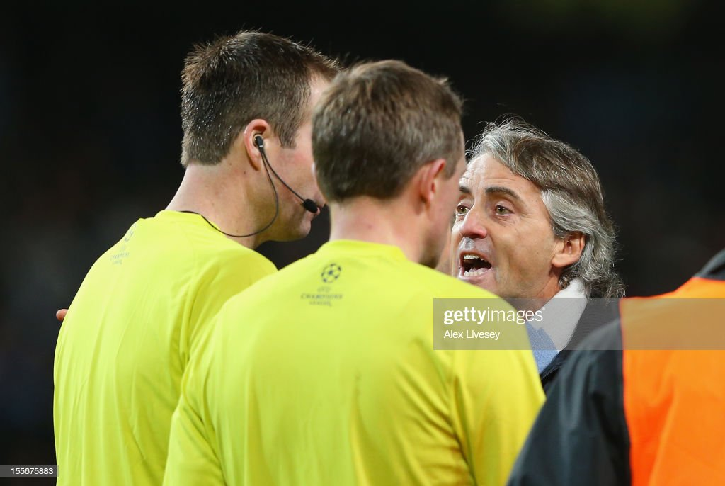 Manchester City Manager <a gi-track='captionPersonalityLinkClicked' href=/galleries/search?phrase=Roberto+Mancini&family=editorial&specificpeople=234429 ng-click='$event.stopPropagation()'>Roberto Mancini</a> protests to Referee Peter Rasmussen after he denied his team a penalty at th eend of the UEFA Champions League Group D match between Manchester City FC and Ajax Amsterdam at the Etihad Stadium on November 6, 2012 in Manchester, England.