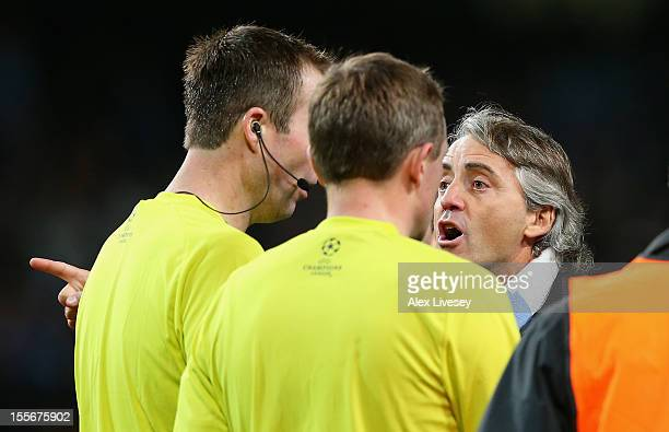 Manchester City Manager Roberto Mancini protests to Referee Peter Rasmussen after he denied his team a penalty at th eend of the UEFA Champions...