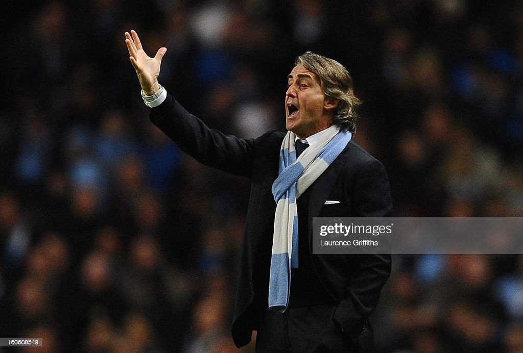 Manchester City Manager Roberto Mancini reacts during the Barclays Premier League match between Manchester City and Liverpool at the Etihad Stadium on February 3, 2013 in Manchester, England.