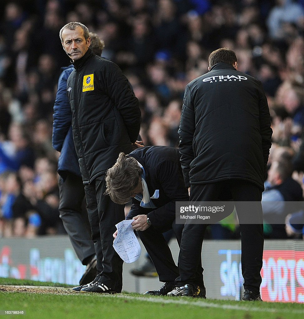 Manchester City Manager <a gi-track='captionPersonalityLinkClicked' href=/galleries/search?phrase=Roberto+Mancini&family=editorial&specificpeople=234429 ng-click='$event.stopPropagation()'>Roberto Mancini</a> reacts during the Barclays Premier League match between Everton and Manchester City at Goodison Park on March 16, 2013 in Liverpool, England.