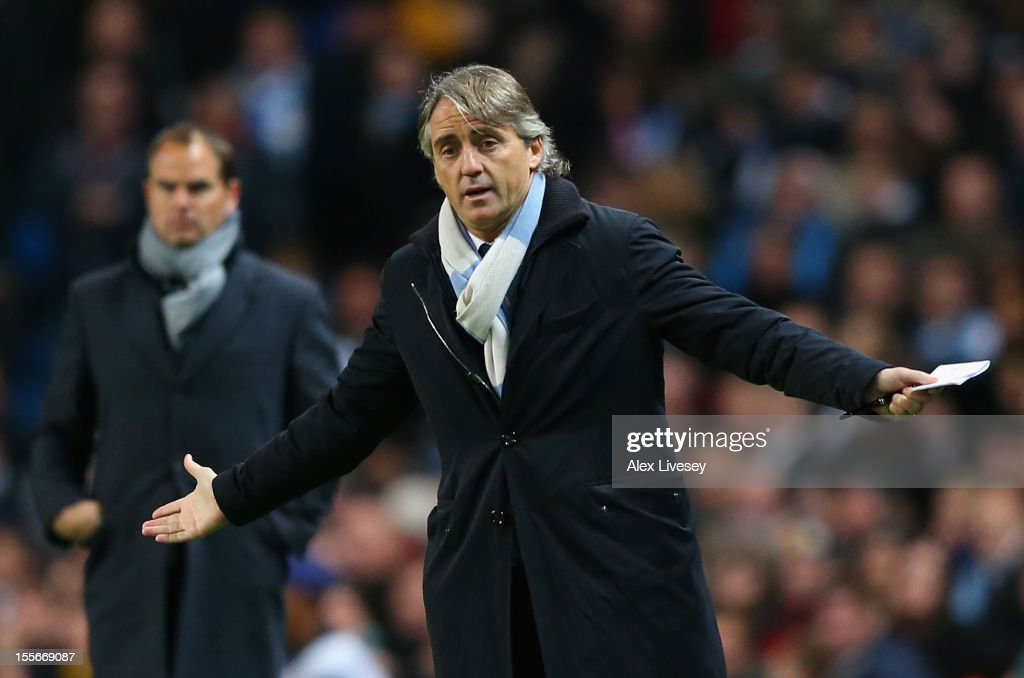 Manchester City Manager <a gi-track='captionPersonalityLinkClicked' href=/galleries/search?phrase=Roberto+Mancini&family=editorial&specificpeople=234429 ng-click='$event.stopPropagation()'>Roberto Mancini</a> reacts during the UEFA Champions League Group D match between Manchester City FC and Ajax Amsterdam at the Etihad Stadium on November 6, 2012 in Manchester, England.