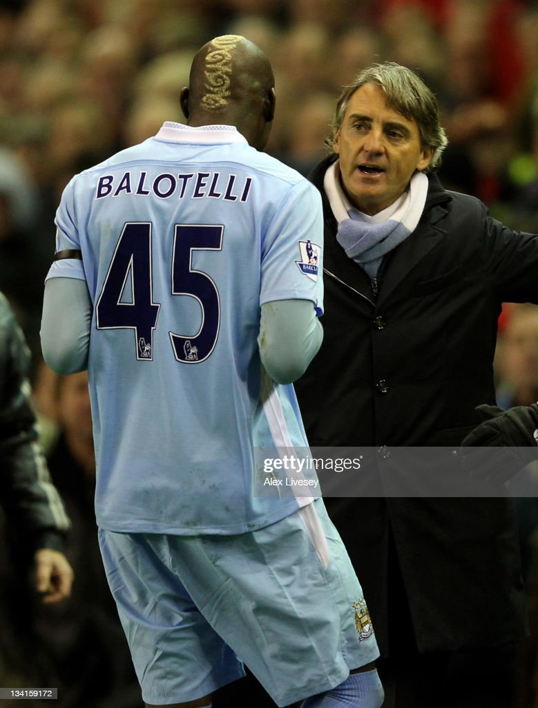 Manchester City Manager <a gi-track='captionPersonalityLinkClicked' href=/galleries/search?phrase=Roberto+Mancini&family=editorial&specificpeople=234429 ng-click='$event.stopPropagation()'>Roberto Mancini</a> speaks to <a gi-track='captionPersonalityLinkClicked' href=/galleries/search?phrase=Mario+Balotelli&family=editorial&specificpeople=4940446 ng-click='$event.stopPropagation()'>Mario Balotelli</a> as he heads for the dressing room after being sent off during the Barclays Premier League match between Liverpool and Manchester City at Anfield on November 27, 2011 in Liverpool, England.